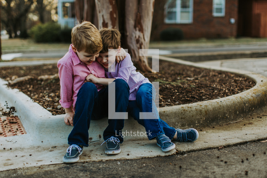brothers hugging