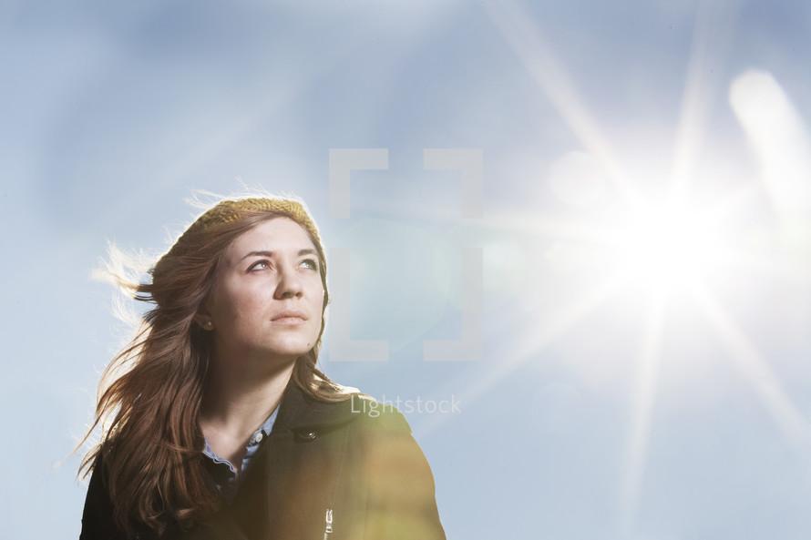 Woman facing the sun.