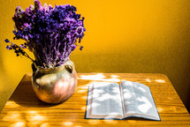 vase of lavender and open Bible on an end table