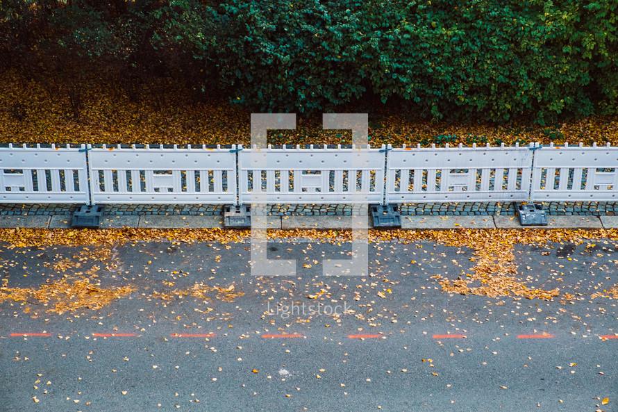 barrier fences on an autumn street