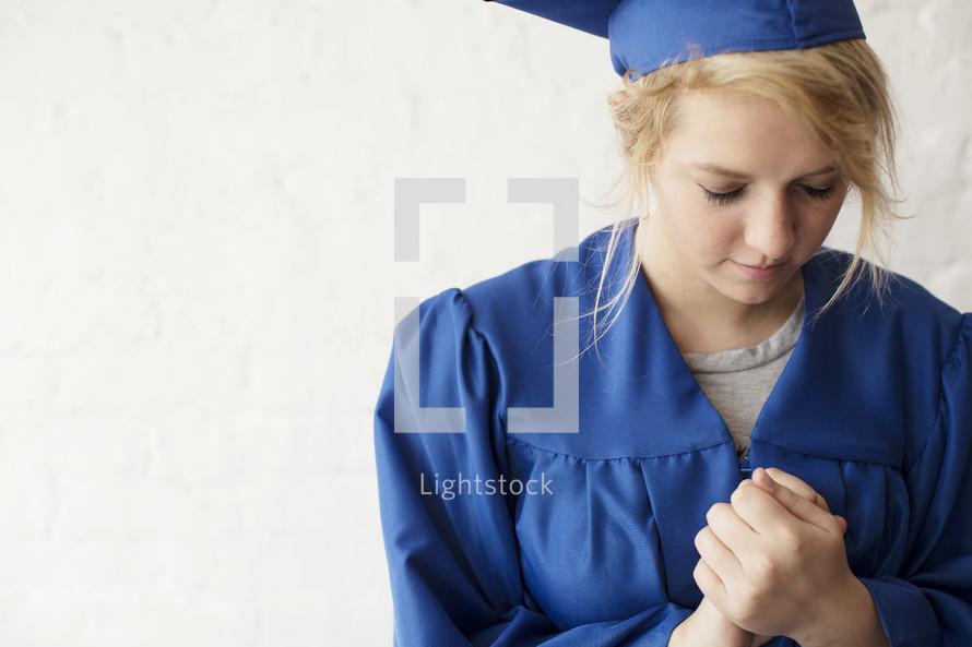 graduate praying