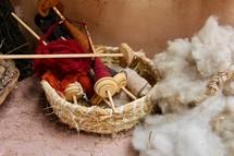 Fleece and wooden bobbins used to handcraft thread