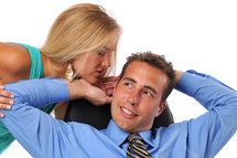 woman kissing a businessman