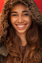headshot of a woman in a winter coat with a hood
