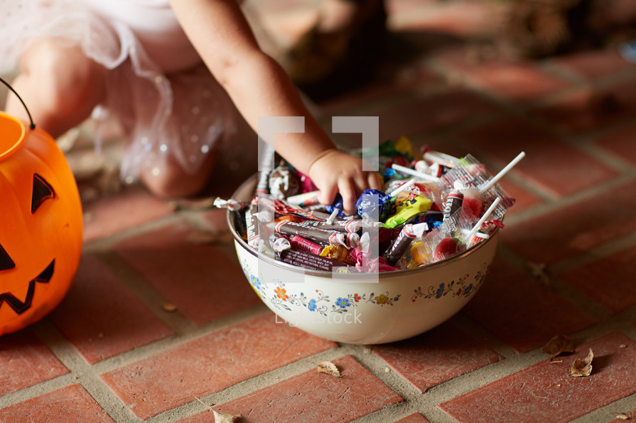 a child trick-or-treating on Halloween