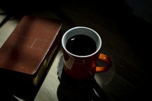 cover of a Bible and coffee mug