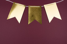 blank gold banner on maroon
