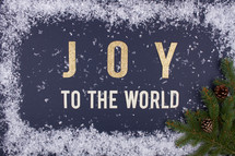 Joy to the world with snow border and green pine