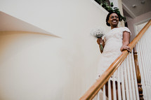 bride with a bouquet on stairs