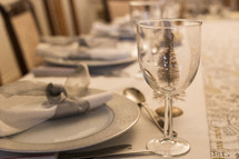 place settings on a table set for Christmas dinner