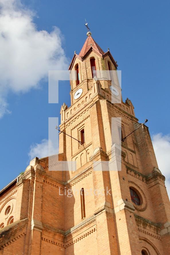 church steeple against a blue sky