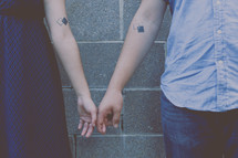a couple with matching tattoos
