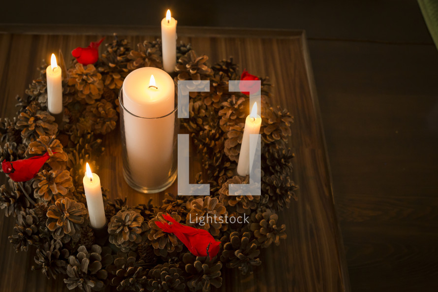 pine cone wreath and candles