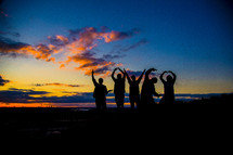 men forming silhouettes of the word love