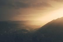 sunlight shining over mountain peaks