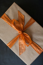 a wrapped gift with an orange bow