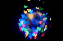 rainbow of bokeh heart lights