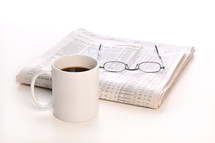 coffee mug, reading glasses, newspaper