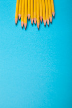 sharpened pencils on a blue background