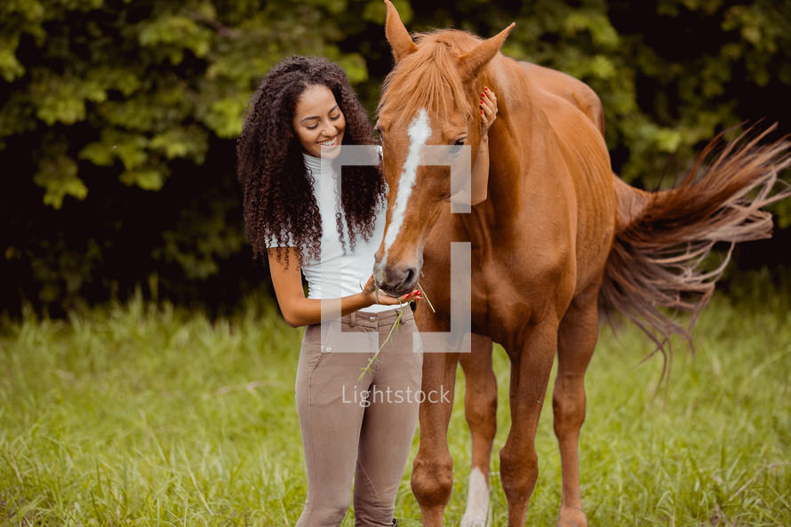 a woman with her horse