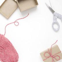 scissors, yarn, and gift box