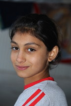 A young Chaldean Christian girl in a refugee camp in Northern Iraq. [For similar search Ethnic Face Smile]