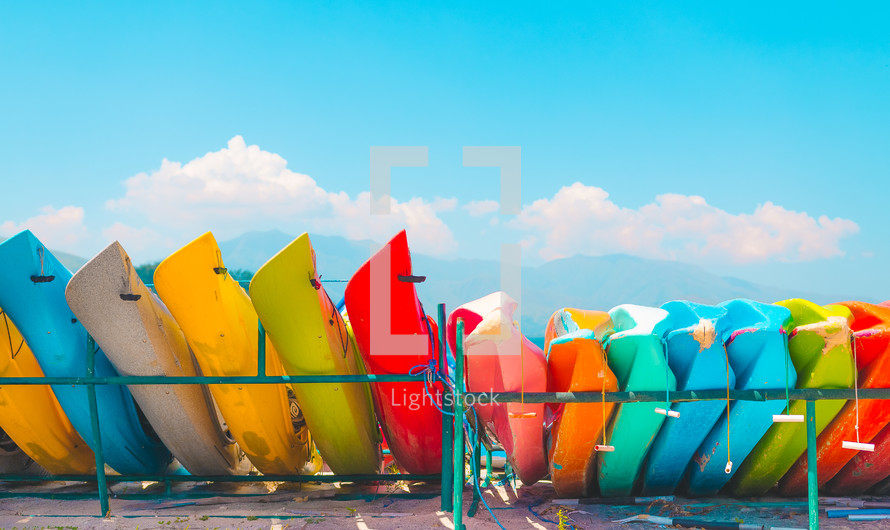 colorful row of canoes