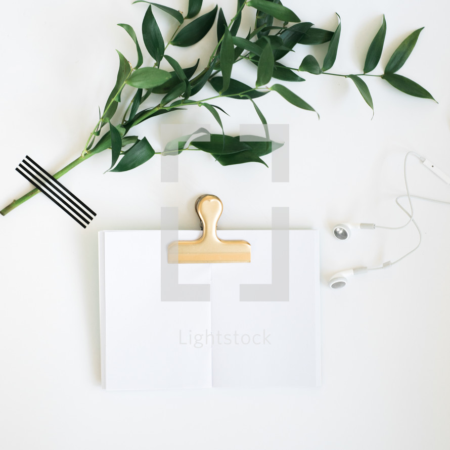 greenery, book clip, journal, and earbuds