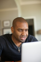 African-American man looking at a compeer screen