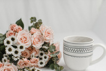 coffee cup and pink flowers