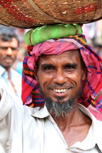 Bangladeshi man with a basket on his head