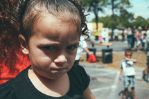 A frowning little girl.