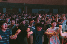 empowered by Christ, youth holding hands and worshiping God