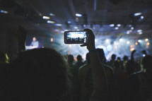 taking a picture at a concert with a cellphone