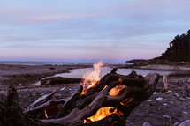fire in driftwood on a beach