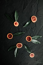 citrus fruit slices and green leaves