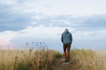 a man walking on a path
