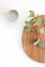 eucalyptus twig, lazy Susan, and votive candle