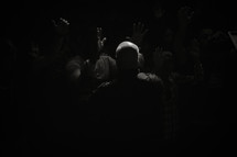 praying over others at a worship service