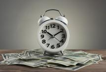 alarm clock on cash