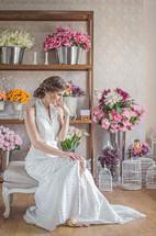 A bride in a flower shop.