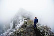 a woman climbing up an icy mountain