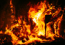 intensely burning house fire