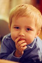 curious face on a toddler boy