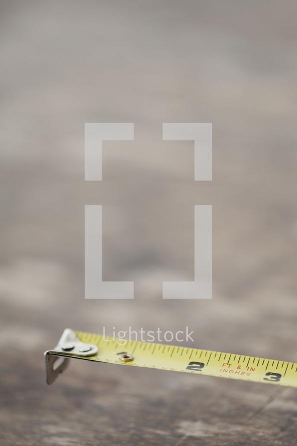 Tape measure on plywood.
