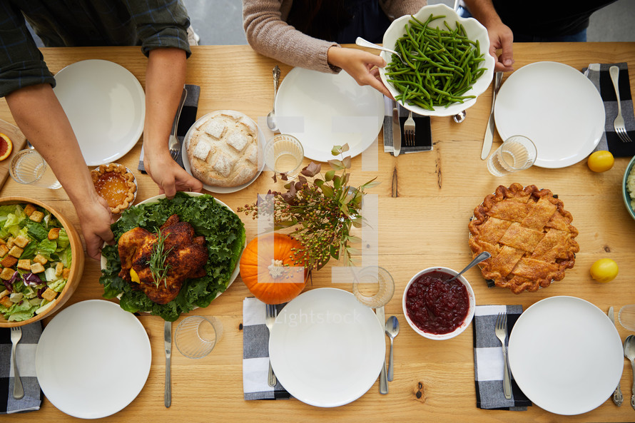 passing food at the Thanksgiving table