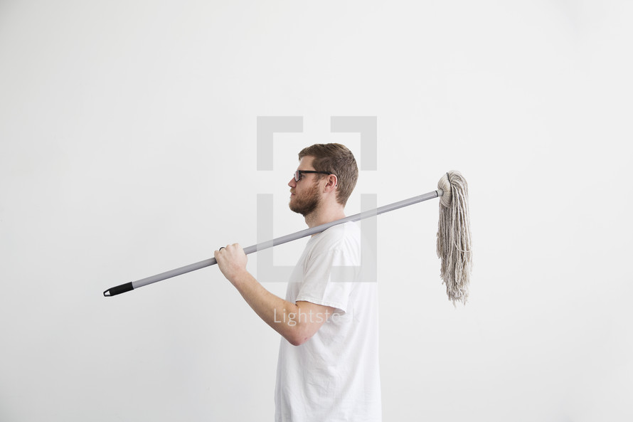man with a mop over his shoulder