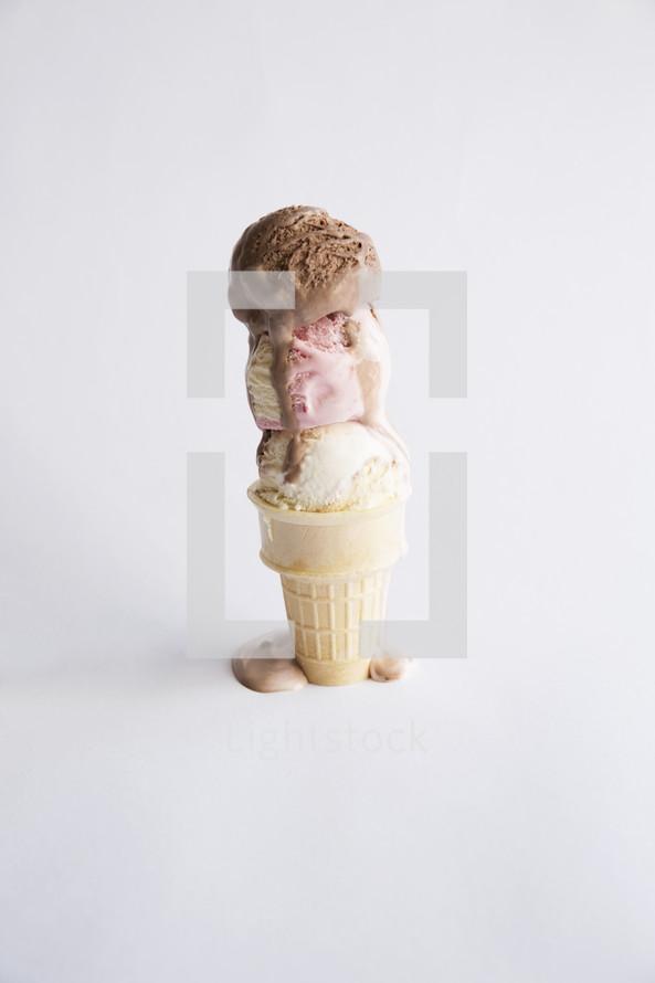 Melting triple scoop of ice cream cone.