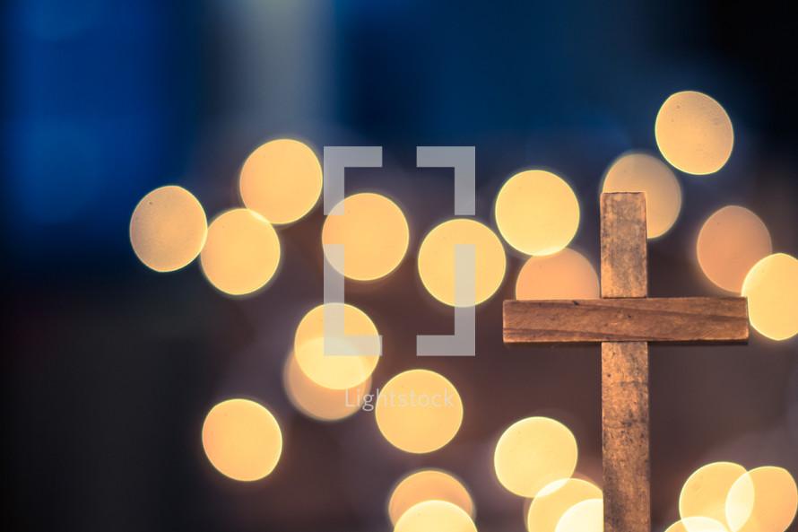 bokeh lights and cross