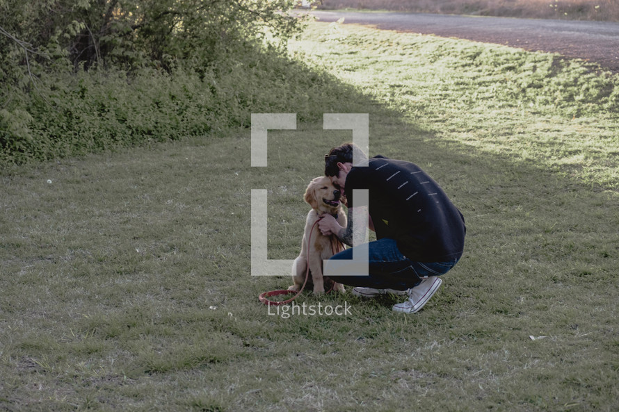 a man walking his puppy